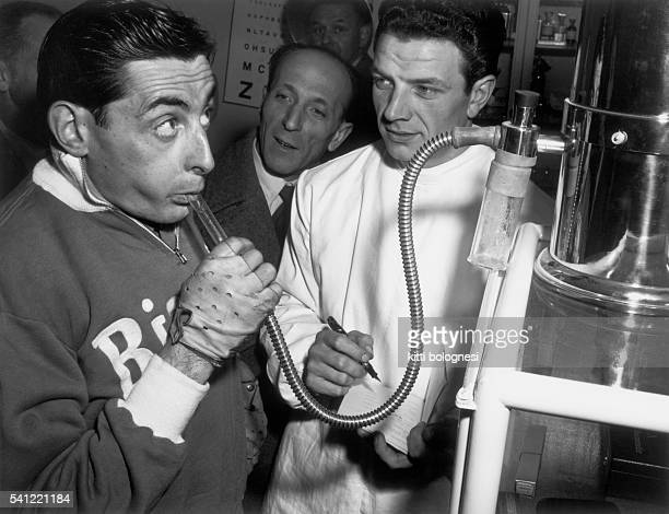 A doctor records supervises testing on champion cyclist Fausto Coppi