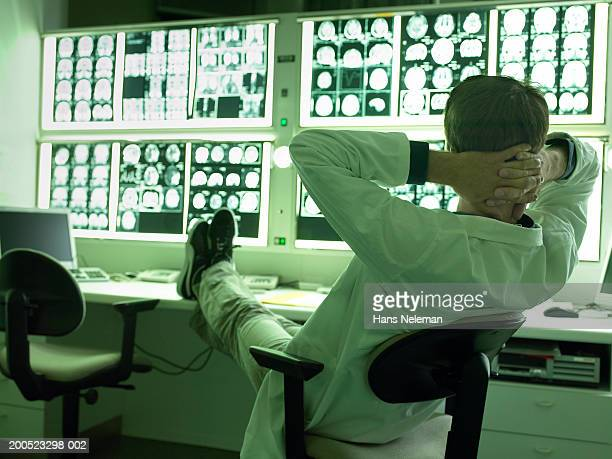 Doctor relaxing with feet up in x-ray laboratory