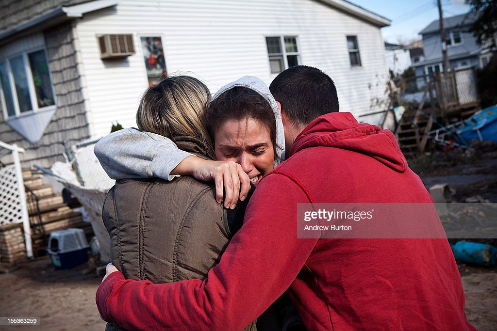 Doctor Rosanna Troia is consoled by volunteers while helping clean out her mother's home in the Midland Beach neighborhood of Staten Island on November 3, 2012 in New York City. As clean up efforts from Superstorm Sandy continue, colder weather and another storm predicted for next week are beginning to make some worried.