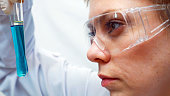 Lab technician or scientist doctor researcher looking at the test tubes in medical clinic chemical laboratory