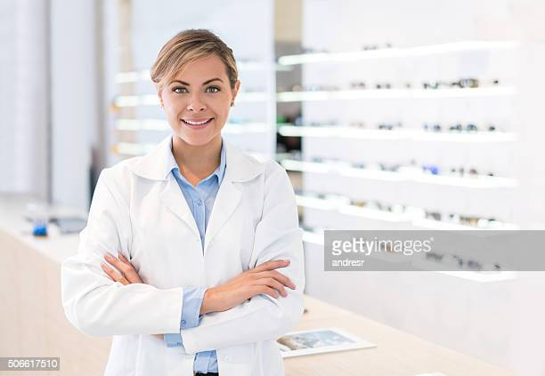 Doctor selling glasses at an optician'€™s shop