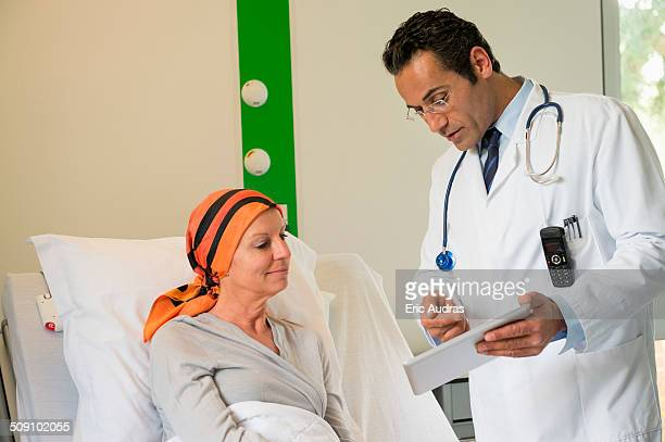 Doctor showing medical report to a patient