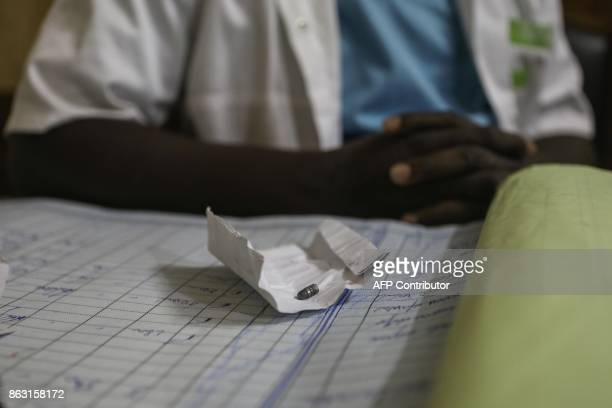 A doctor shows the bullet he removed from the leg of a patient following antigovernment demonstrations at Gbenyedji medical center in Lome on October...