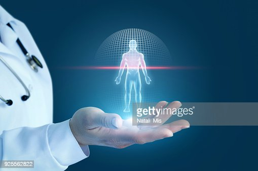Doctor shows the process of scanning a patient . : Stock Photo