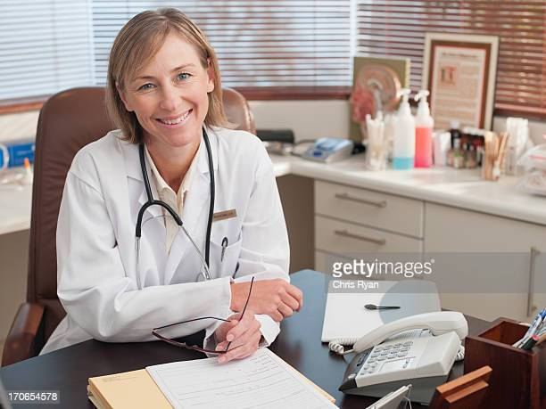 Doctor sitting at desk in office