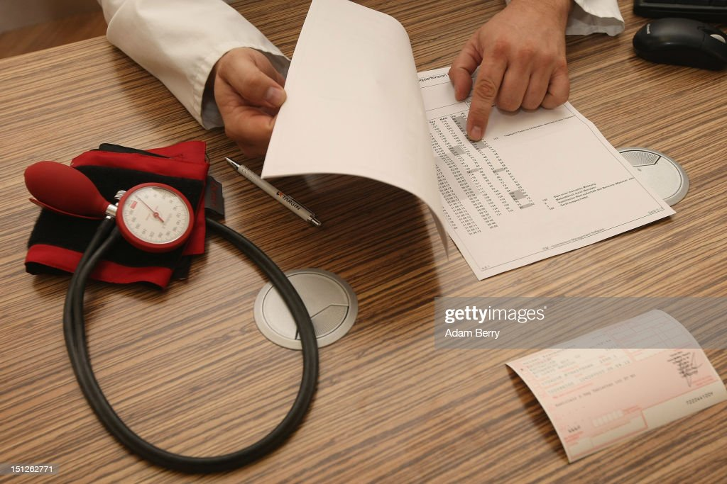 . A doctor speaks with a patient about her high blood pressure, or hypertension, on September 5, 2012 in Berlin, Germany. Doctors in the country are demanding higher payments from health insurance companies (Krankenkassen). Over 20 doctors' associations are expected to hold a vote this week over possible strikes and temporary closings of their practices if assurances that a requested additional annual increase of 3.5 billion euros (4,390,475,550 USD) in payments are not provided. The Kassenaerztlichen Bundesvereinigung (KBV), the National Association of Statutory Health Insurance Physicians, unexpectedly broke off talks with the health insurance companies on Monday.