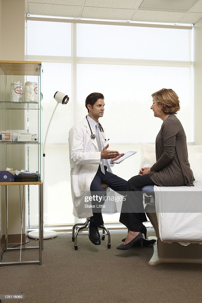 Doctor Speaks with Female Patient : Stock Photo