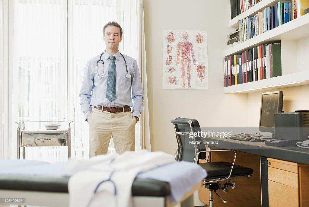 Doctor standing in doctors office