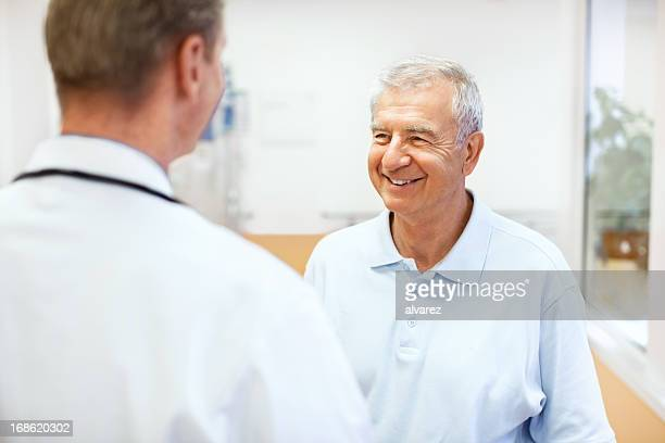 Doctor talking to a patient at the hospital