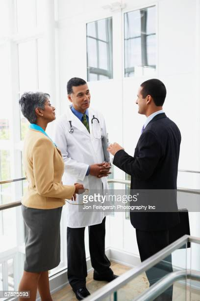 Doctor talking to businesspeople