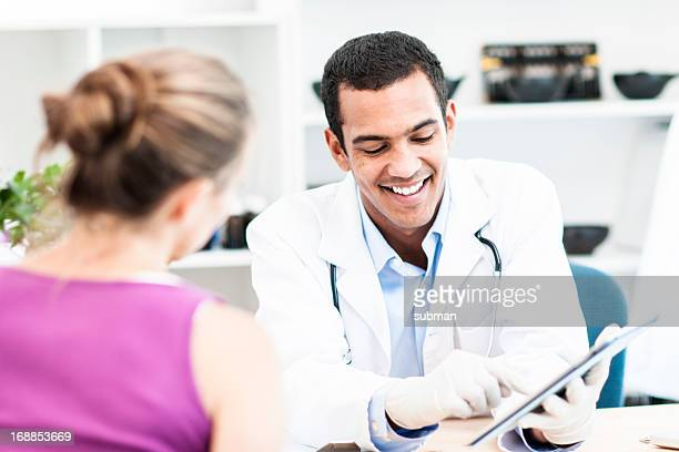 Doctor talking to female patient