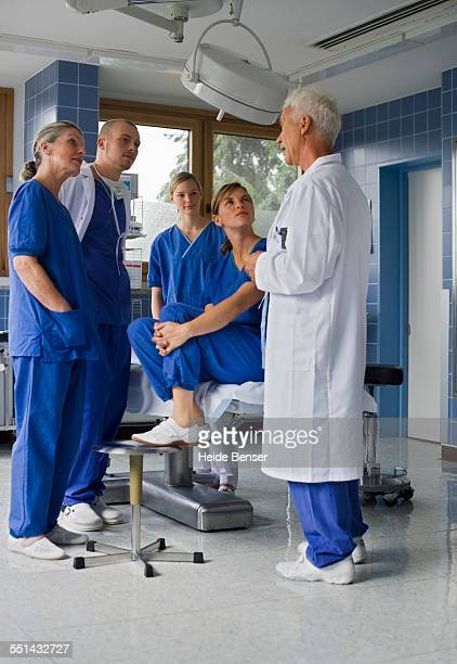 Doctor Talking to Interns in Operating Room