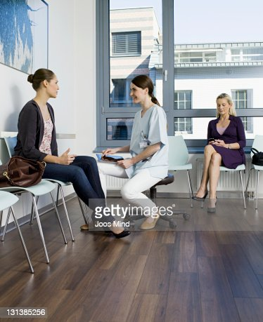 doctor talking to patient using digital tablet : Stock Photo