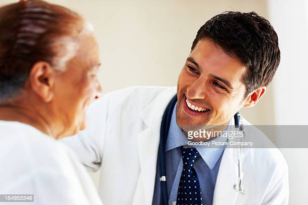 Doctor talking to senior patient