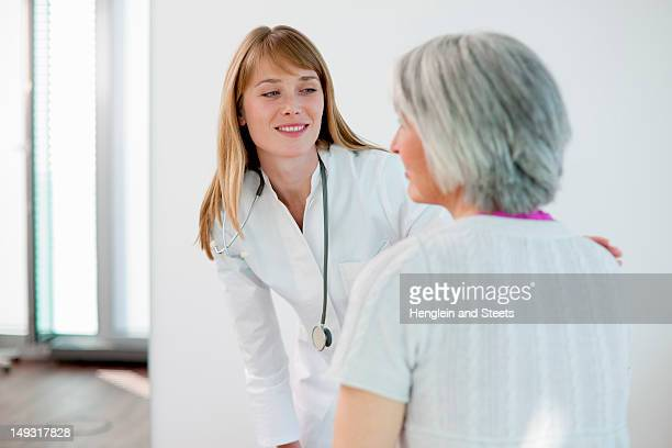 Doctor talking to woman in office