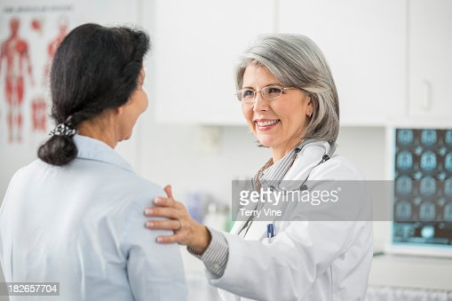 Doctor talking with patient in office : Stock Photo