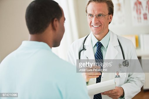 Doctor talking with patient : Stock Photo
