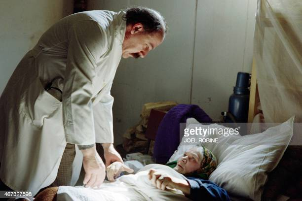 A doctor talks to a Muslim woman on February 26 1993 in the basement of a building transformed into a hospital in Hrasnica village near the Sarajevo...