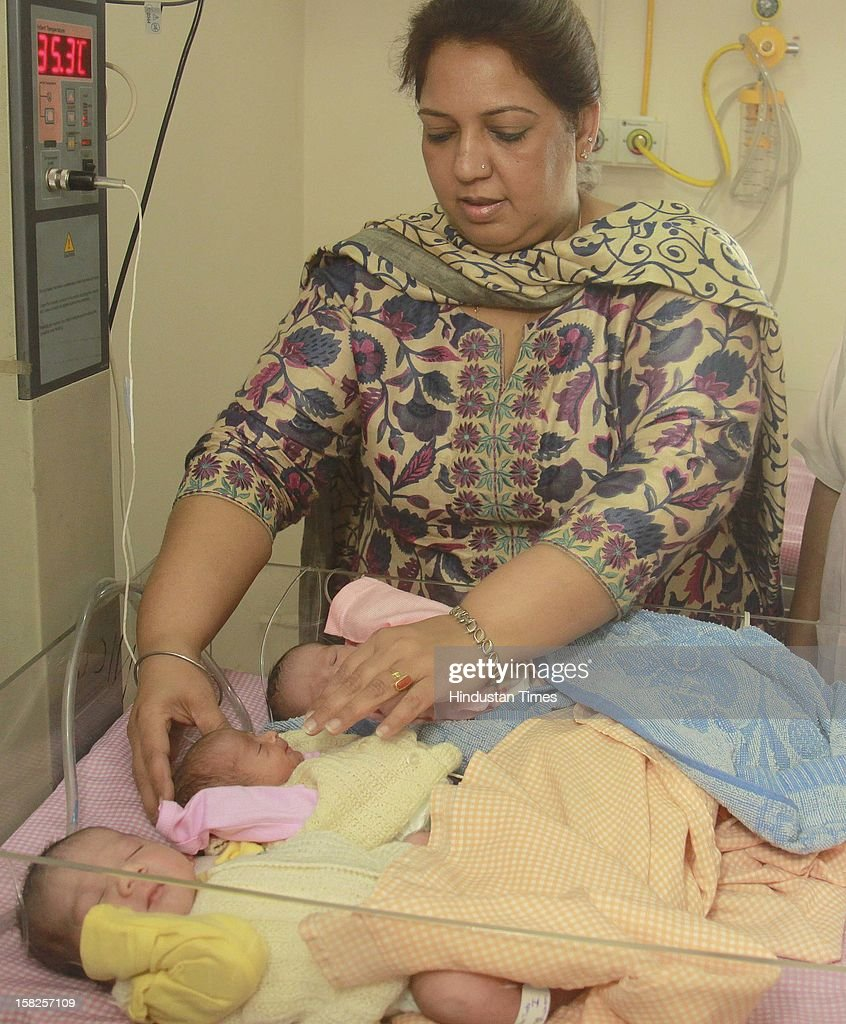Doctor tending to Triplet Babies one girl and two boys born to Asha and Ravi Thukral at Kalra Hospital on December 12, 2012 in New Delhi, India. The birth of triplet become special due to their unique birth date of 12.12.12 that is considered lucky by many numerologists.