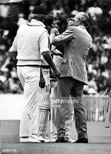 A doctor tends to Australian Rick McCosker for a broken jaw during the Centenary Test at the MCG March 1977 THE AGE Picture by STAFF