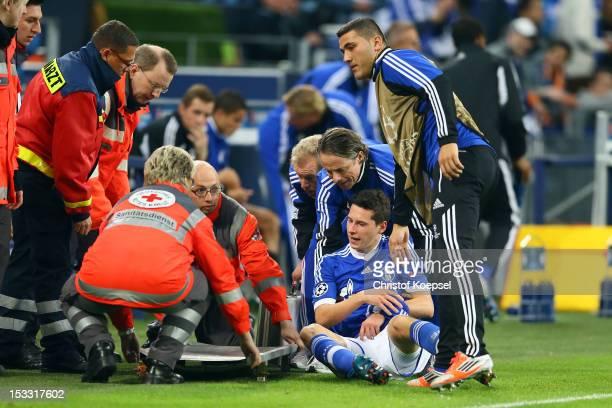 Doctor Thorsten Rarreck treats Julian Draxler of Schalke after an injury during the UEFA Champions League group B match between FC Schalke 04 and...