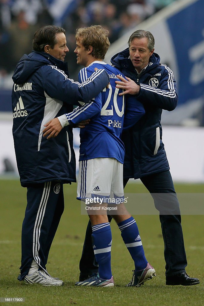 Doctor Torsten Rarreck, Teemu Pukki and head coach Jens Keller of Schalke celebrate after winning 3-0 the Bundesliga match between FC Schalke 04 and TSG 1899 Hoffenheim at Veltins-Arena on March 30, 2013 in Gelsenkirchen, Germany.