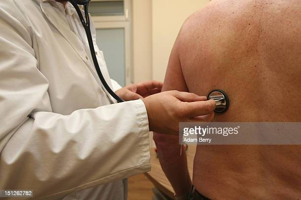 A doctor uses a stethoscope on a patient on September 5 2012 in Berlin Germany Doctors in the country are demanding higher payments from health...