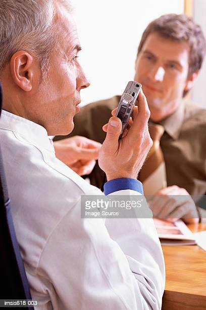 Doctor using a dictaphone