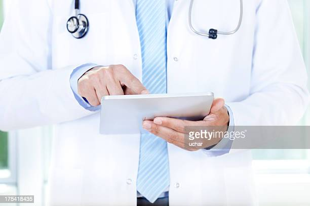 A doctor using a tablet to research better treatment options