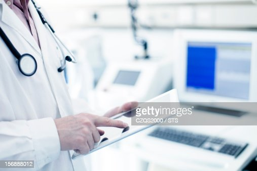 Doctor using digital tablet in hospital