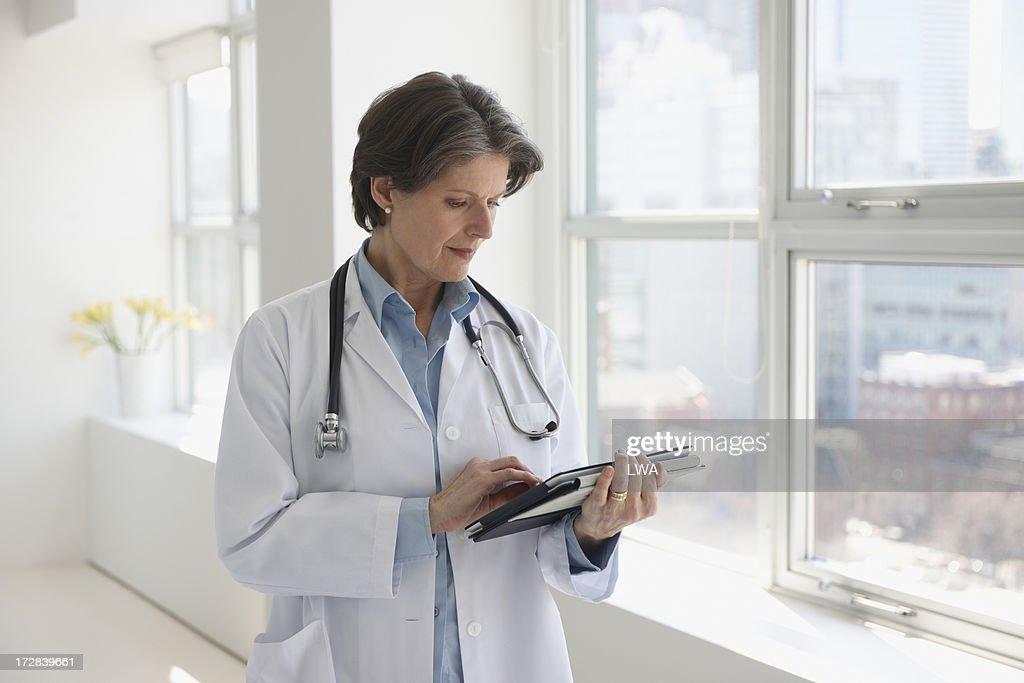 Doctor using digital tablet : Stock Photo