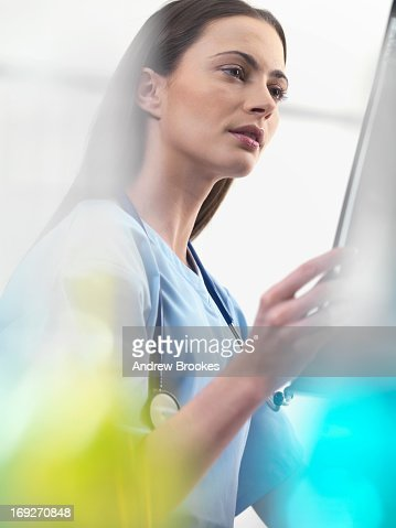 Doctor using tablet computer in hospital : Stock Photo