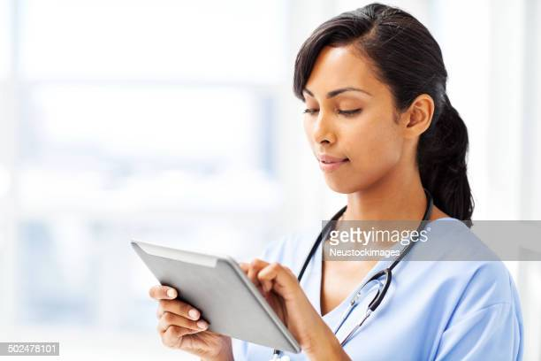 Doctor Using Tablet Computer In Hospital