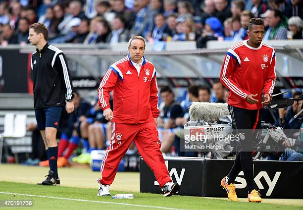 Doctor Volker Braun new club doctor of Muenchen looks on during the Bundesliga match between 1899 Hoffenheim and FC Bayern Muenchen at Wirsol...