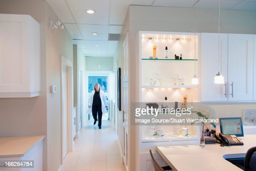 Doctor walking in office hallway : Stock Photo
