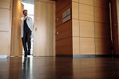 Doctor walking in office hallway
