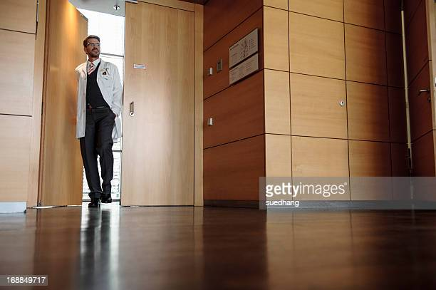 Doctor walking in office hallway