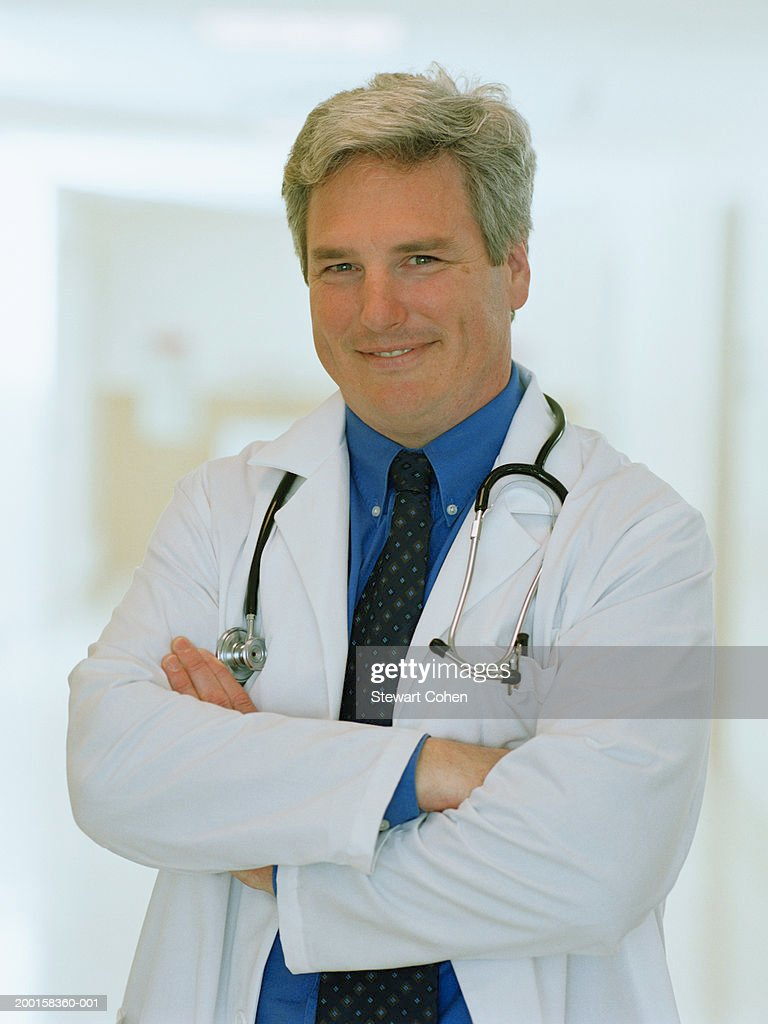 Doctor wearing stethoscope around neck, portrait : Stock Photo