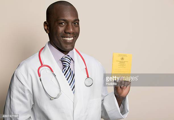 Doctor wearing stethoscope holding German Immunisation Certificate
