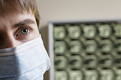 Doctor wearing surgical mask,  close-up