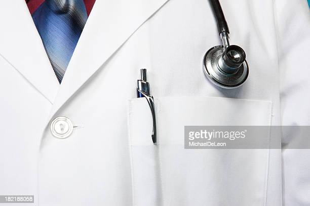 Doctor wearing white lab coat with stethoscope on their neck