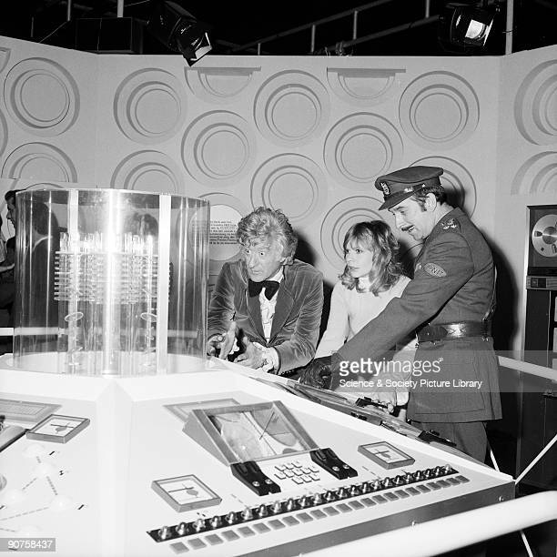 Doctor Who cast members Jon Pertwee Katy Manning and Nicholas Courtney in character at the opening of the BBC TV Visual Effects exhibition at the...