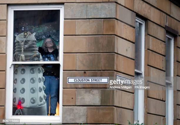 Doctor Who fan Erica Quinn looks out from her window after she turned her house into her very own Tardis Life sized cardboard cutouts of the Tenth...