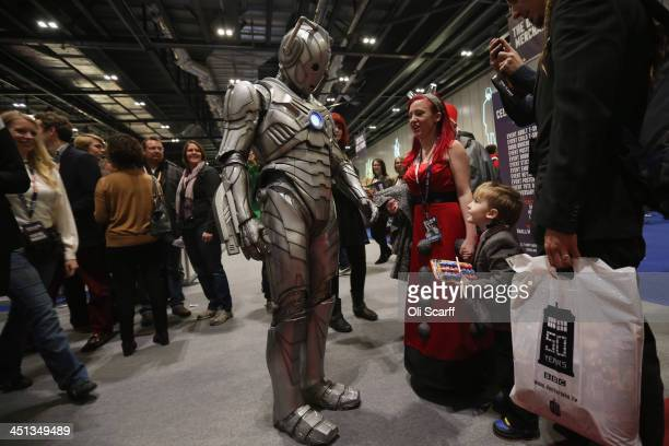 Doctor Who fans meet an actor dressed as a 'Cyberman' at the 'Doctor Who 50th Celebration' event in the ExCeL centre on November 22 2013 in London...