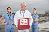 Doctor with box of urgent human organs on rooftop