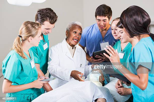 Doctor with group of medical students