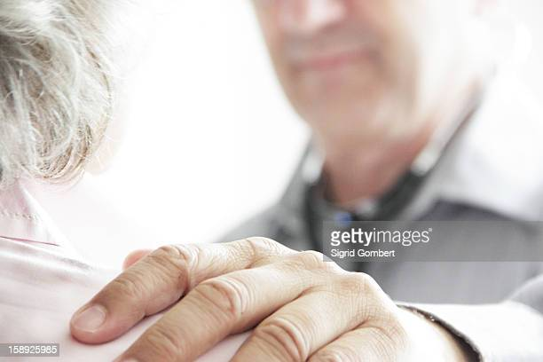 Doctor with hand on patients shoulder