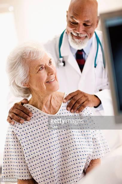Doctor with Hands on Patient's Shoulders