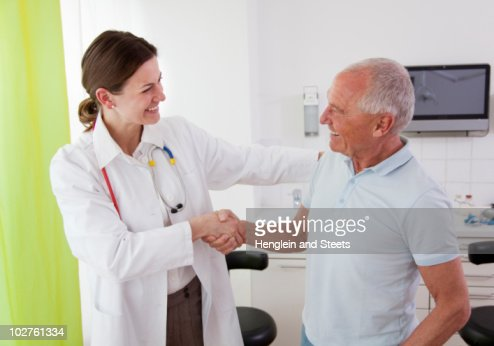Doctor with patient in surgery : Stock Photo