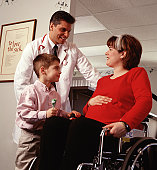 Doctor with Pregnant Mom and Son